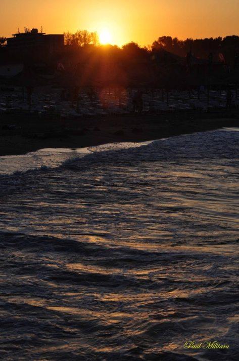 sunset on rough sea